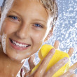 Stock Photo: Teenage Girl Taking a Shower. Bathing.Washing