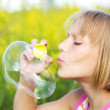 Little Girl Blowing Soap Bubbles — Stock Photo #10746952