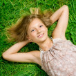 Royalty-Free Stock Photo: Happy Girl Lying On A Green Grass