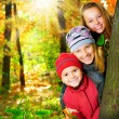 Happy Kids Having Fun in Autumn Park.Outdoors - Stock Photo