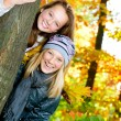 Beautiful Teenage Girls Having Fun in Autumn Park .Outdoor — Stok fotoğraf
