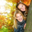 Beautiful Teenage Girls Having Fun in Autumn Park .Outdoor — Stock Photo #10746982