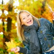 Stock Photo: Beautiful Teenage Girl Having Fun in Autumn Park .Outdoor