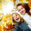 Beautiful Teenage Girls Having Fun in Autumn Park .Outdoor — Stock Photo #10746988