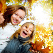 Beautiful Teenage Girls Having Fun in Autumn Park .Outdoor — Stock Photo #10746990