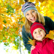 Happy Kids in Autumn Park — Stockfoto