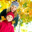 Stock Photo: Happy Kids in Autumn Park