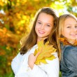Beautiful Teenage Girls Having Fun in Autumn Park .Outdoor — Stock fotografie