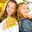 Beautiful Teenage Girls Having Fun in Autumn Park .Outdoor — Stock Photo