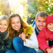 Happy Big Family With Kids Walking in Autumn Park. - Stock Photo