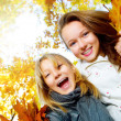 Stock Photo: Beautiful Teenage Girls Having Fun in Autumn Park .Outdoor
