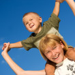 Stock Photo: Happy Kids. Sister And Brother Outdoor