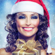 Christmas Woman with Gift — Stock Photo #10747080