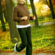 Young woman jogging outdoor - 图库照片