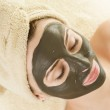 Spa. Mud Mask On The Woman's Face — Stock Photo