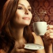Beautiful Woman Drinking Coffee — Stock Photo #10747380