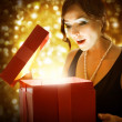 Christmas or New Year Gift. Surprised Woman — Stock Photo #10747394