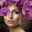 Beautiful Woman Portrait With Orchid Flowers Over Black — Stock Photo