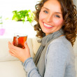 Beautiful Young Woman drinking hot tea — Stock Photo