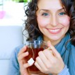 Beautiful Young Woman drinking hot tea — Stockfoto