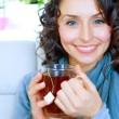 Beautiful Young Woman drinking hot tea — Stock Photo
