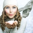Christmas Girl. Winter woman Blowing Snow - Stok fotoğraf