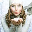 Christmas Girl. Winter woman Blowing Snow — Stock Photo