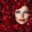 Beautiful Woman's Face and rose petals. Perfect Skin — Стоковое фото