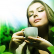 Beautiful Girl Drinking Healthy Green Tea. Healthcare or Herbal - Stock Photo