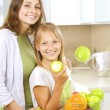 Happy Mother with Daughter eating Healthy food. Diet. Healthy Ea — Stock Photo #10747925