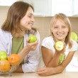 Happy Mother with Daughter eating Healthy food. Diet. Healthy Ea — Stock Photo