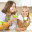 Happy Family Mother with her Daughter eating Healthy food. Diet. - Zdjęcie stockowe