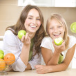Happy Family Mother with her Daughter eating Healthy food. Diet. — Stock Photo
