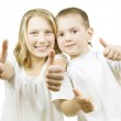 Happy Kids Sister and Brother with thumbs up. — Stock Photo #10748115