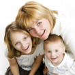 Happy family. Mother with kids over white — Stock Photo #10748165