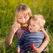 Stock Photo: Happy Sister And Brother Blowing Soap Bubbles