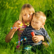 Happy Sister And Brother Blowing Soap Bubbles — Stock Photo