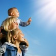 Healthy Family Outdoor. Happy Mother With Kids Over Blue Sky — Stock Photo #10748205