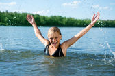 Happy Cute Little Girl Swimming In Water — Stock Photo