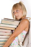 Back To School. Little Schoolgirl With Heavy Books — Stock Photo