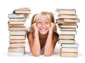 Back To School Concept. School Girl Between The Stacks Of Books — Stock Photo
