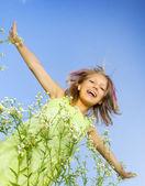 Happy Little Girl flying.Outdoors — Stock Photo