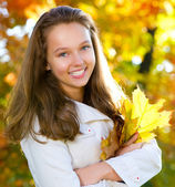 Beautiful Teenage Girl in autumn park — Stock Photo