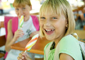 Happy Schoolgirls Eating Ice Cream — Stockfoto