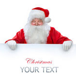 Santa Claus holding Banner with Space for Your Text — Foto de Stock