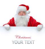 Santa claus holding banner con espacio para su texto — Foto de Stock