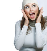 Happy Young Beautiful Woman. Surprised winter Girl over white — Stock Photo