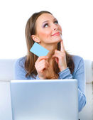 Happy Woman shopping on-line with credit card and computer.Inter — Stock Photo