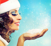 Christmas Girl.Winter woman Blowing Snow — Stock Photo