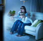 Mother with Daughter watching 3d film on TV — Stock Photo